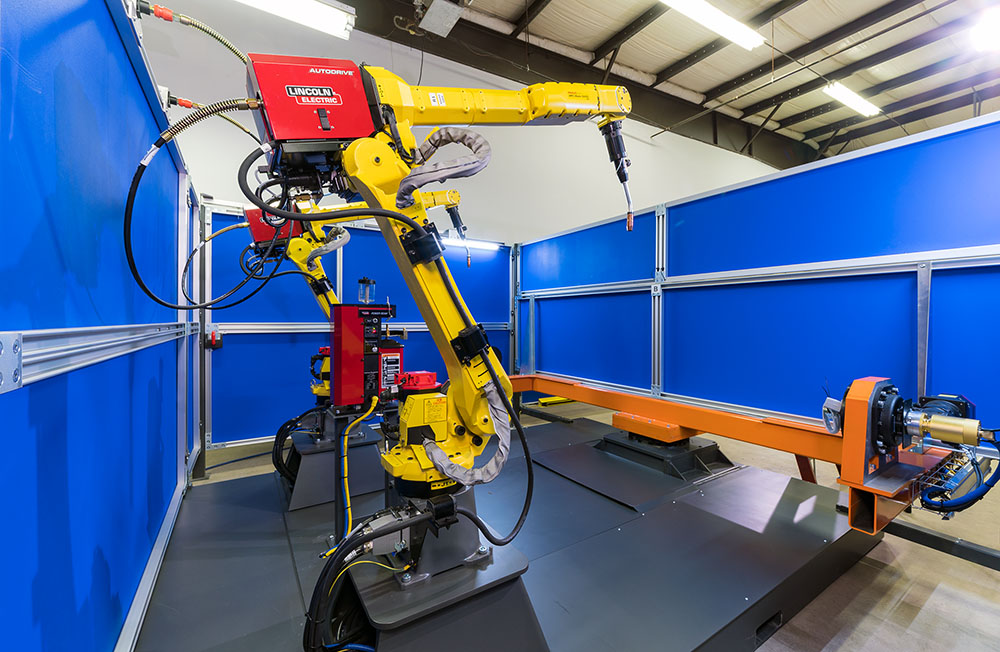 welding robots inside the preconfigured welding automation cell from TranTek Systems